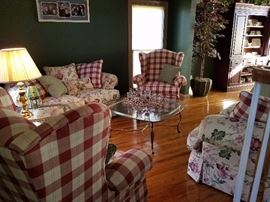 View of family room furniture for sale. Notice sofa and matching loveseat.