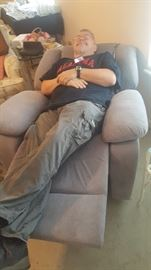 Glenn, hard at work as usual, making sure the recliner is comfortable and functioning properly. From the smile on his face I think it's a go.
