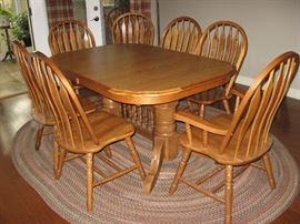 "Trestle Oak Dining Room Table with Two Captain Chairs & Six Side Chairs with Two 18"" Leaves Stored in Table, One of the Three Matching Braided Rugs..."