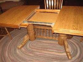 "Dining Table showing the Two 18"" Leaves Stored in Table,  also notice one of the Three Matching Braided Rugs..."