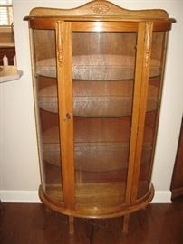 Beautiful Lighted Curved Glass Curio Cabinet...