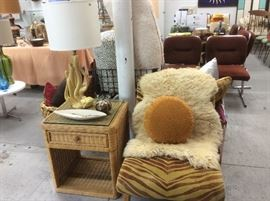 Zebra slipper chair with sheepskin, wicker side table, cactus lamp