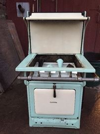 Capital Gas Stove - green and white enamel - Great Depression era. Has legs, missing stove top.