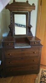 Antique Eastlake Victorian mirrored dresser with marble inset.