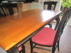 TABLE WITH BLACK LEGS, THE TOP OF THE TABLE MADE FROM AN ANTIQUE DOOR FROM ENGLAND