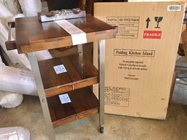 Folding kitchen island with original box (no assembly required), plus additional unopened island in box