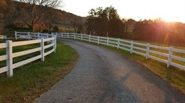 About a 1/2 Mile of White Vinyl Fencing