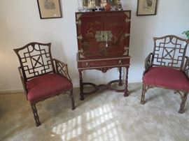 Pair of bamboo look chairs. Oriental cabinet is an old one.