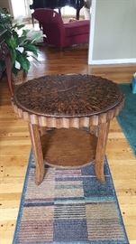 Designer table with inlaid top from Charles Cudd.
