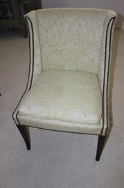 One of four upholstered chairs with hobnail trim.