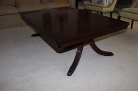 Duncan Phyfe dining table cut down to coffee table height.