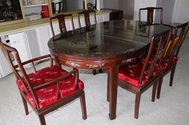Asian themed oval diningtable with mother of pearl and abilone inlaid table, 6 chairs with removable satin cushions.