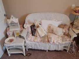 Wicker set includes Love seat, end table, and 2 chairs