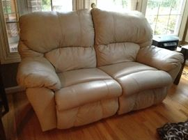 Leather loveseat - reclines on both side $ 300.00