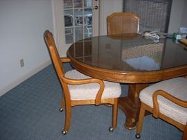Oval Wood Table with 4 Chairs (on rollers)
