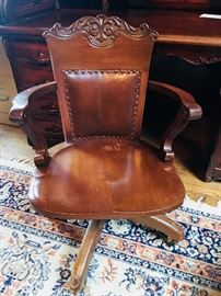 This early 1900's office chair is one of a kind!  The owner has cherished this statement piece and it is in beautiful condition. It's a must see to appreciate its beauty.