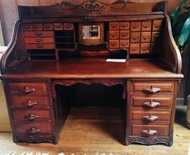 Made in the USA, this masterpiece desk was so beautifully crafted, Globe Desk presented it at the St. Louis, MO World's Fair in 1904 and then burned the architectural design to it as it was too special to replicate. It is absolutely the ONLY one like it. The buyer of this will have a treasure. Email us to place a bid today!!!!