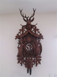 "Extraordinary Cuckoo Clock, ""After The Hunt"", carved in the Black Forest of Germany by Hubert Herr, a master carver.  Circa 1970's.   Works fine!    28"" wide X 54"" high."