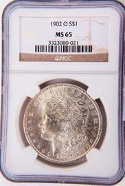 Lot 20a - Coin 1902-O Morgan Silver Dollar NGC MS65