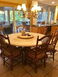 Table has two additional leaves and removeable Lazy Susan (pictured).  Six chairs w/ rush seats.
