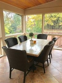 Stone dining table w/woven natural fiber chairs
