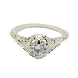 Late Edwardian 18K White Gold Solitaire Diamond Engagement Ring: A late Edwardian 18K white gold filigree engagement ring showcasing a single diamond.