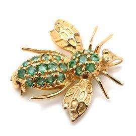 14K Yellow Gold Natural Emerald Bee Pin: A 14K yellow gold bee pin adorned with natural emeralds to the abdomen and thorax. Pin has a 10K yellow gold pin stem.