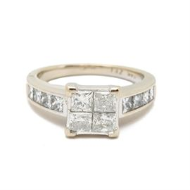 14K White Gold 2.16 CTW Diamond Ring: A 14K white gold statement ring showcasing a high-mounting with four princess-cut diamonds and more to the shoulders.