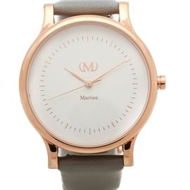 Martian CL06 mVip Rose Gold Plated Smartwatch: A Martian CL06 mVip smartwatch featuring a white dial, a rose gold plated stainless steel case with a gray leather band. It includes its cord and charger.