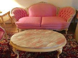 French Provincial sofa with pink marble coffee table
