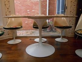 Kitchen:    This is a closer photo of the tulip bases on the table and the chairs.  The TABLE SOLD but the chairs are still available.