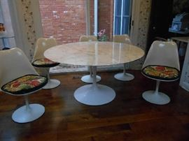 Kitchen:  This vintage Eero Saarinen (by Knoll) tulip table SOLD.  But the five tulip chairs are still for sale.