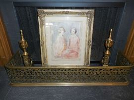 """Living Room:  A vintage brass fireplace fender (44"""" wide by 9"""" tall) envelops brass andirons and an original piece of art.  It is a  framed watercolor  portrait of two women by listed Australian artist Bess Norriss-Tait.  The art measures 18"""" x 12,"""" without the frame."""