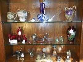 Living Room:  Many of the collectibles are still available.   But the Royal Doulton Flambe is reserved per a bid.