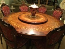 inlaid dining room with lazysusan and 8 chairs.
