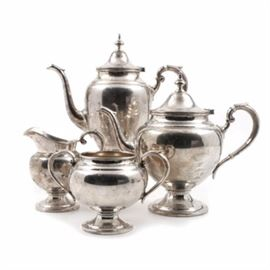 "1966 Gorham Sterling Silver Coffee and Tea Service: A vintage sterling silver coffee and tea service by Gorham in the pattern numbered 451. The set is simple and classic in styling comprising a footed coffee pot, teapot, creamer and two handled sugar; both the coffee pot and teapot are marked to be 2.5 pints with reinforced handles and faux ivory insulators. All pieces are stamped with the Gorham pseudo hallmarks, ""Gorham Sterling"", ""Reinforced Handle"", and a date code of a number six in a hexagonal cartouche for 1966. The total appropriate weight, including the reinforced handles, is 55.225 ozt."