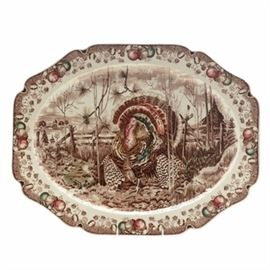 "Vintage Johnson Bros. ""His Majesty"" Turkey Platter, Made in England: A vintage Johnson Bros. His Majesty turkey platter, made in England. The extra large platter feature a genuine hand engraving in sepia to depict the turkey in his full glory at the center of a farm landscape. The rectangular platter has a scalloped rim illustrated with fruit and fall flowers."