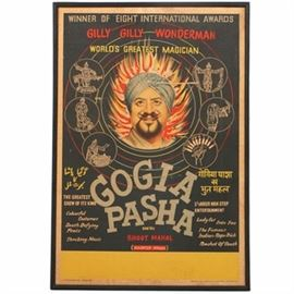 "Mid 20th-Century Chromolithograph Poster on Paper ""Gogia Pasha"": A chromolithograph poster on paper advertising a show for the magician Gogia Pasha (Dhanraj Gogia, Indian, 1910 – 1976), dated to the early to mid 20th-century. The magician performed under an assumed Egyptian identity with a large troupe that included dancers, assistants, and more. The piece is mounted onto cardboard and is housed in a painted wood frame without glass."