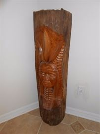 native american carved log