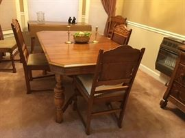 Jacobean style/ Jacobean revival  Reaser Furniture Company       Ghettysburg, Penna      Dining Room Table, Sideboard, and 6 chairs.  One chair is an armchair.