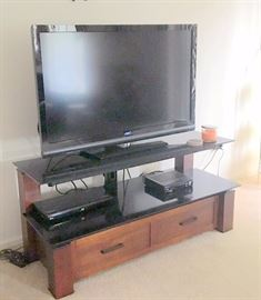 Big Screen TV and tv Stand unit.