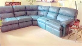 Leather reclining curved sectional. Perfect condition.