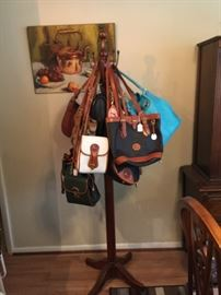 Some of the many quality purrs tat will be available.  Dooney and Bourke, Coach. Michael Kors, etc.  Many accessories, clothes, shoes, boots, and bags --some new, some vintage.