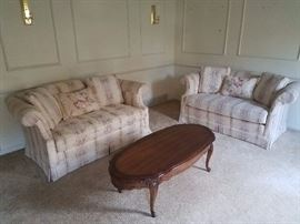 Pair of matching love seats and queen anne coffee table.