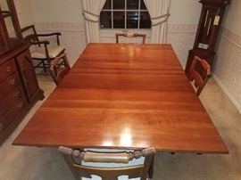 Solid Wood drop leaf dining room set with 6 chairs.