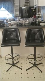 Black swivel bar stools by Admiral Furniture
