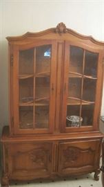 China cabinet with glass doors on top and two shelves below