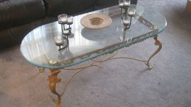 Oval gold wrought iron glass top coffee table