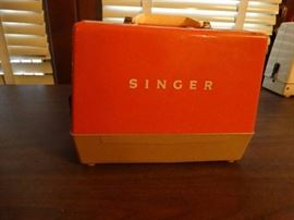Mini vintage singer electric sewing machine.