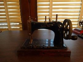 Mini vintage sewing machine.